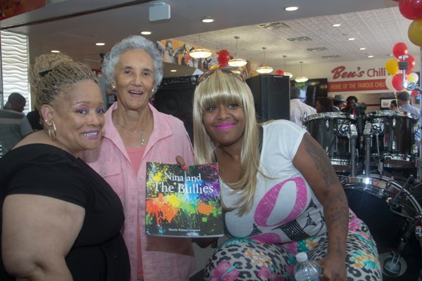 Ben's Chili Bowl matriarch Virginia Ali greets Michelle Williams Turnipseed (left) and Takeesa Donelson (right) during the opening of the restaurant's newest location at National Airport in Arlington, Va., on Wed., July 23.