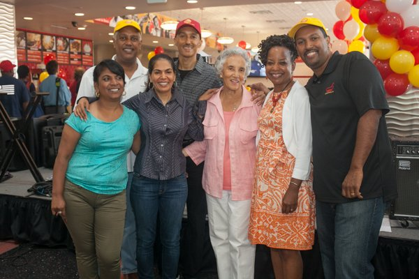Ben's Chili Bowl family members at the opening of the restaurant's new location at National Airport in Arlington, Va., on Wed., July 23.
