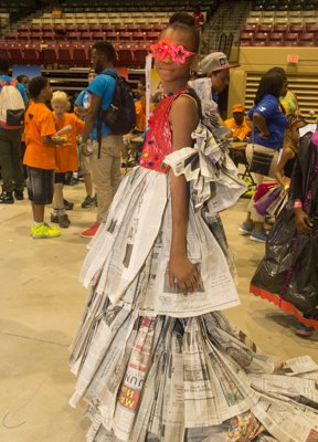 Najah Terrell prepares to walk the runway in her fashion design during the Trashion Fashion event at the Thingamajig Conference hosted by the YMCA of Metropolitan Washington at Show Place Arena in Upper Marlboro, Md., on Thurs., July 24.