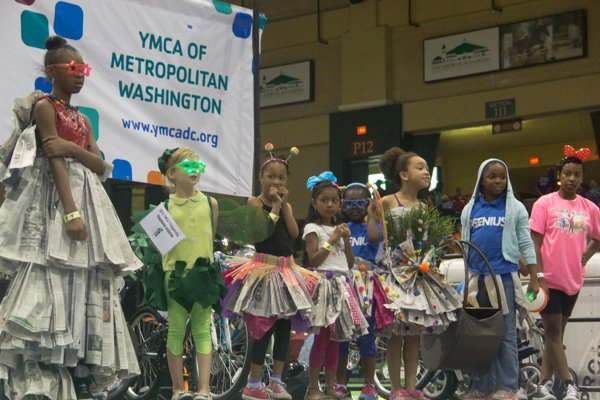 Children who designed the most outstanding fashions out of newspapers and other material had the opportunity to model their creations on stage during the Thingamajig Conference hosted by the YMCA of Metropolitan Washington at Show Place Arena in Upper Marlboro, Md., on Thurs., July 24.