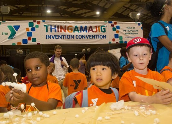 Mason Denson, Mitsuru Ishitara, and Jacob Mudd from the YMCA in Alexandria attend the Thingamajig Conference hosted by the YMCA of Metropolitan Washington at Show Place Arena in Upper Marlboro, Md., on Thurs., July 24.