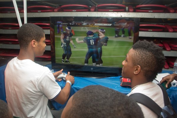 Mt. Pleasant Baptist Church summer camp teens, Jesse Garner and Clayton Washington, play Madden on the Xbox at the Thingamajig Conference hosted by the YMCA of Metropolitan Washington held at Show Place Arena in Upper Marlboro, Md., on Thurs., July 24.