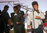Chadwick Boseman (right) as James Brown and Nelsan Ellis (left) as sidekick Bobby Byrd.