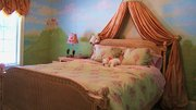 Christian created a landscape in this girl's bedroom, matching the scenery to the room's decor.