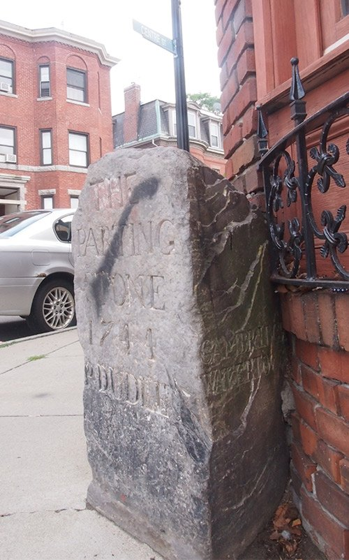 Stone mile markers and boundary stones tucked away on Roxbury street corners tell stories of the neighborhood's 18th century history.