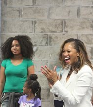 """Smile, chins up!"" Felicia Gibson Jaycox (center) reminds her future models