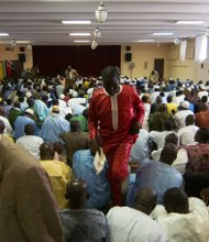 A crowd listens to Khassida, musical settings of the poems of Cheikh Ahmadou Bamba Mbacke.