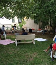 "Patrons attending Harlem Grown's ""Film on the Farm"" movie nights."