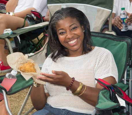 Concert goer enjoys the food during 2014 Spirit Festival held at Merriweather Post Pavilion in Columbia, Md., on Sat., August 2.