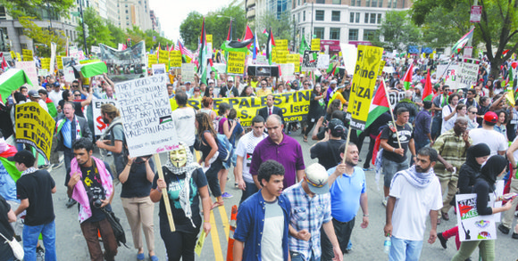 Tens of thousands of demonstrators marched to the White House on Aug. 2 to express their outrage against Israel's most ...