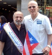 Felix D. Arroyo and Warren Tolman pose along the Puerto Rican parade route.