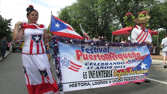 The three-day Puerto Rican Festival brought thousands to City Hall Plaza for live music, carnival rides and a parade.