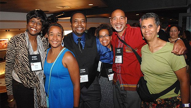 Carmen Fields, Kimberly Frazier-Booth, Marcus Jones, Lisa Simons, Derrick and Michelle Jackson enjoy a moment during the annual convention of the National Association of Black Journalists held last week at the Hynes Convention Center.