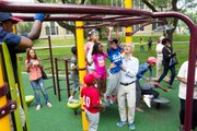 Chicago Mayor Rahm Emanuel plays with children in the newly renovated Jackie Robinson Park, following the ribbon cutting last week.