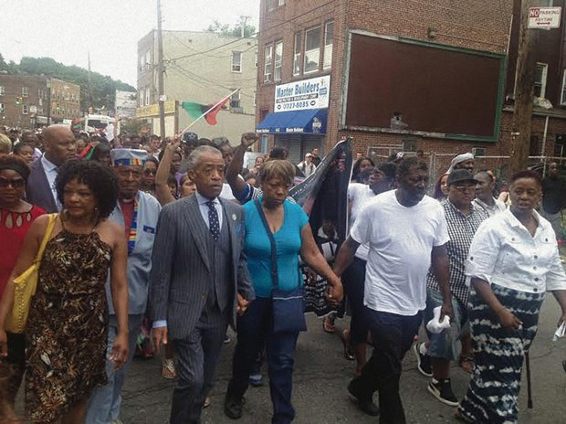 Staten Islanders rallied from the Mount Sinai Center to the 120th Precinct to demand justice for NYPD chokehold victim Eric Garner. The Rev. Al Sharpton announced an Aug. 23 1 p.m. march across the Verrazano Bridge. Visit nationalactionnetwork.net for details. (Khorri Atkinson photo)