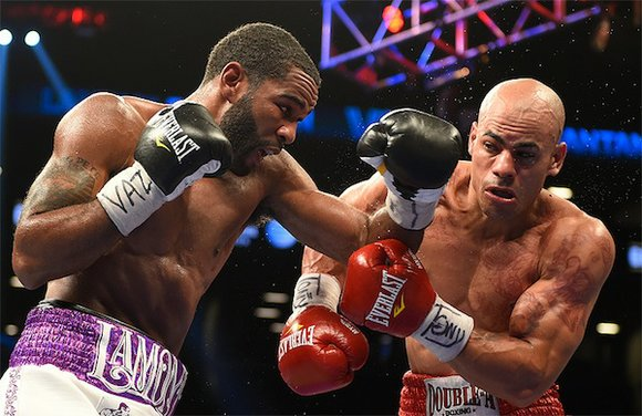 Lamont Peterson retained his IBF junior welterweight title with a dominating 10th-round technical knockout victory over Edgar Santana.