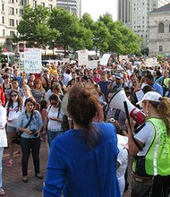 Immigration activists rally at Copley Square before marching to the Boston Common last week. While the GOP-controlled Congress passed a measure that would have expedited deportations of child immigrants, Democrats are advocating evaluating immigrants on a case-by-case basis. (Banner photo)