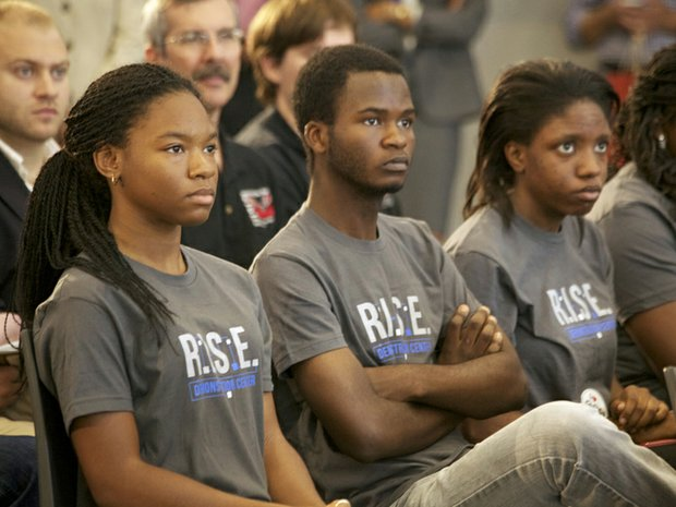 McKinley Tech students (seated left to right) J'Niya Butler, 15 , Cabrel Foyet-Fokov, 17 and Angel Collins, 15 at the grand opening of R.I.S.E. Demonstration Center located at St. Elizabeths East Wed., August 13.