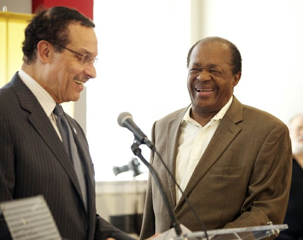 Mayor Vincent Gray invites Ward 8 Councilmember Marion Barry to the podium during the grand opening of R.I.S.E. Demonstration Center located at St. Elizabeths East, Wed., August 13.