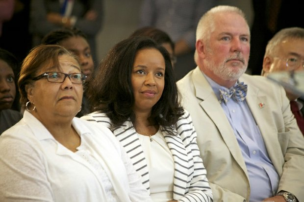 D.C. Council member Anita Bonds (at-large), Catherine Buell of St. Elizabeths East and Brian Hanlon, director of the Department of General Services, listen to Mayor Vincent Gray during the grand-opening ceremony of R.I.S.E. Demonstration Center at St. Elizabeths East on Wednesday, Aug. 13.