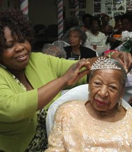 Barnett Burrowes, program manager of Stuyvesant Heights Center, crowns Queen Mary Glenn