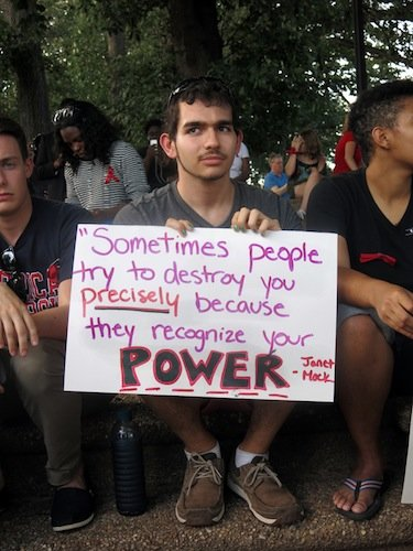 American University student Derek Siegel, 21, holds a sign during a demonstration in Meridian Hill/Malcolm X Park in Northwest D.C. on Aug. 14 to protest the killing of a black teenager in Ferguson, Missouri, earlier in the month.