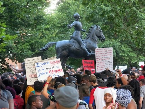 About 2,000 people gathered in Meridian Hill/Malcolm X Park in Northwest D.C. on Aug. 14 to demonstrate against the killing of a black teenager in Ferguson, Missouri, earlier in the month.