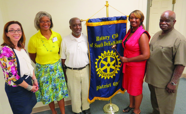South DeKalb Rotary Club President Patricia Seals, with gavel,  poses with, from left, District 6900 Assistant Gov. Candace Klein; president-elect, Dr. Jennifer Friday; Sergeant-at-arms Willie Hinton; and treasurer William Murrain. Klein installed Seals and the club's officers on Aug. 13. The club meets Wednesdays at noon.
