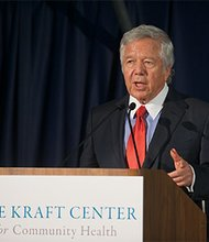 Pictured here congratulating Kraft Fellows and Practitioners at the first annual Kraft Center for Community Health Leadership Symposium is Robert Kraft.