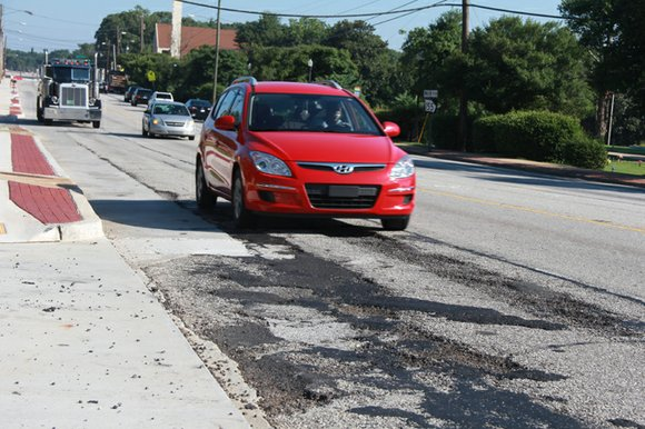 Candler Road, which has been home to traffic jams, metal plates and bumpy concrete patches for more than a year, ...