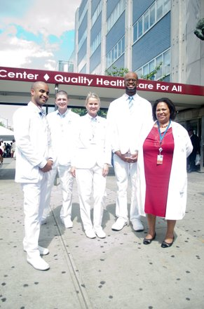 Doctors from the Harlem Hospital Center, School of Radiology showoff their extra white coats as the prepare to speak on-air at the WHCR- Harlem Community Radio booth. #HarlemWeek (08/17/2014)In the photo from left to right; Eladio Lopez, Jason Pepé, Kamilla Kijet, Lenworth Burnette and Stephanie Evans (Director of Education),