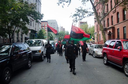 Grassroots activists march down 134th celebrating the legacy of Pan-African icon, Marcus Mosiah Garvey, on his birthday. #HarlemWeek (08/17/2014)