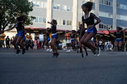 Cheerleaders and a band perform on 135th. #HarlemWeek (08/17/2014)