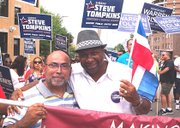 Walter Gonzalez and Suffolk County Sheriff Steve Tompkins enjoy a moment during the Dominican parade. (Banner photo)