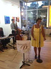 Senabella and Bobby Irving perform at Gallery Guichard, 432 E. 47th St, during the second annual Bronzeville Nights, a series of events designed to support local businesses in Chicago's Bronzeville community.