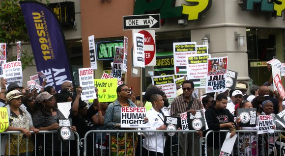 Harlemites traveled to Staten Island called for justice for both Eric Garner's death as well as the killing of Michael ...