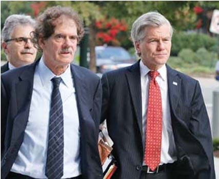 Former Virginia Gov. Bob McDonnell, right, arrives at federal court Tuesday with his attorney Henry Asbill.