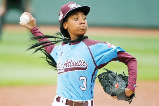 Strikeout phenom Mo'Ne Davis fires a pitch for Philadelphia in her historic 4-0 win over Tennessee.
