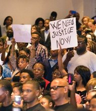 Citizens in Ferguson, Mo. attend a rally at local church.