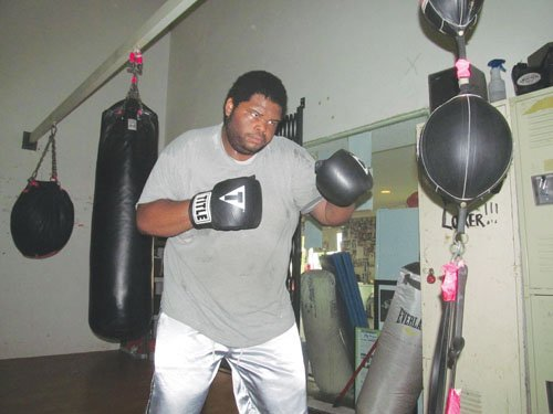 When Portland fighter Quincy Blanton isn't working on his boxing skills at the Grand Avenue ring in northeast Portland, he is working jobs at United Parcel Service and as a bouncer at a downtown nightclub.