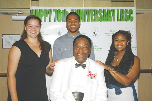 Roy Jay of the African American Chamber of Commerce, master of ceremonies for the 79th anniversary of the Portland Leisure Hour Golf Club, poses with the student club members who won scholarships during the recent celebration, Briget Lang (from left), Silas Melson and Kenya Spears.