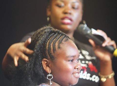 Ten-year-old Dejanyse Holland models a natural hairstyle by Simone Monae Johnson.