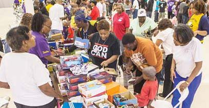 Last year's event: Parents brought their children to look over the shoe offerings as hundreds waited their turn at the host site, Second Baptist Church on South Side.