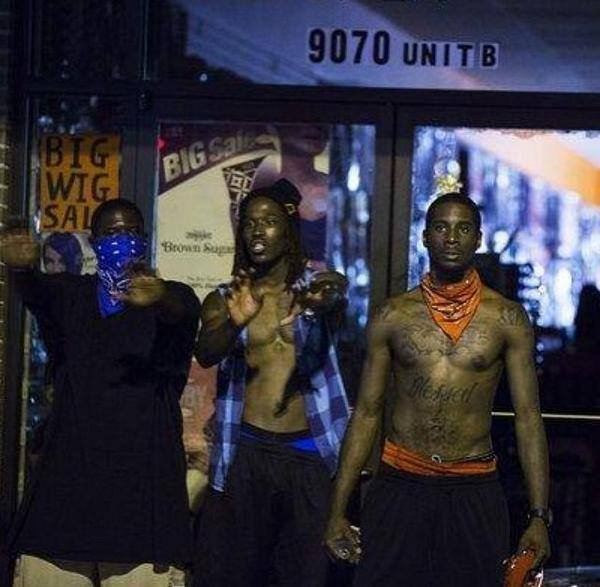 Crips and Blood gang members come together to protect a store from looking in Ferguson, Mo.