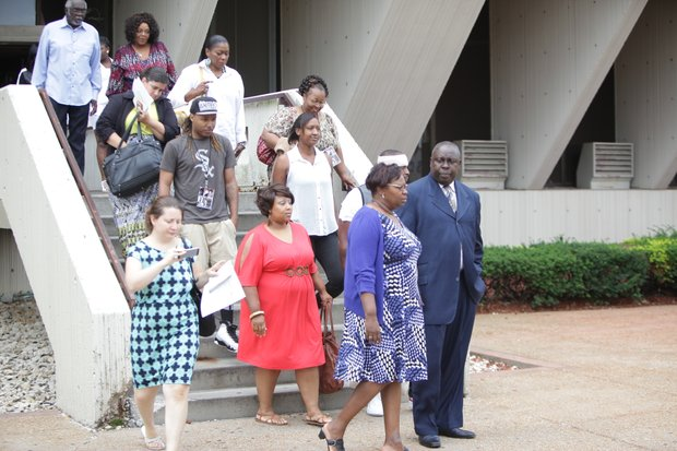 The families of Terrance Rankins and Eric Glover leave the Will County Courthouse in Joliet following the guilty verdict issued against Bethany McKee for their murders.