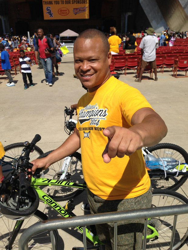 Ill. State Rep. Ken Dunkin (Dist.-5), a bike riding enthusiast, couldn't help but smile after seeing the Jackie Robinson West Little League team honored at Millennium Park, last Wednesday.