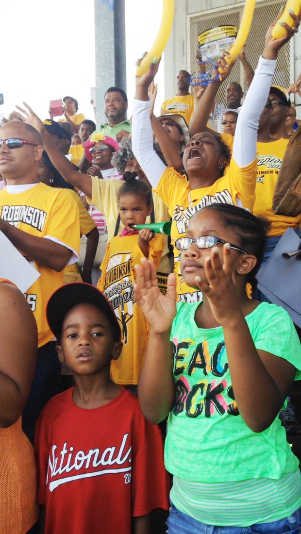 Young fans of the Jackie Robinson West All-Stars display a wide range of emotions as the team was announced on the loud speaker during a citywide celebration for the team at Millennium Park in downtown Chicago on August 27th, 2014.
