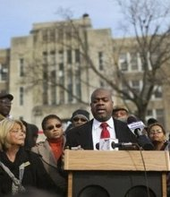 "Mayoral candidate Ras Baraka, standing outside Weequahic High School in Newark, New Jersey, attacks Superintendent Cami Anderson's ""One Newark"" plan. (Courtesy Photo)"
