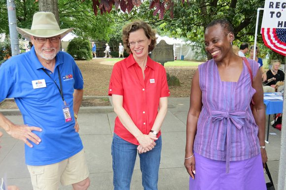 U.S. Senate candidate Michelle Nunn shares a light moment with Lithonia Mayor Deborah Jackson and Decatur Mayor Jim Baskett at ...