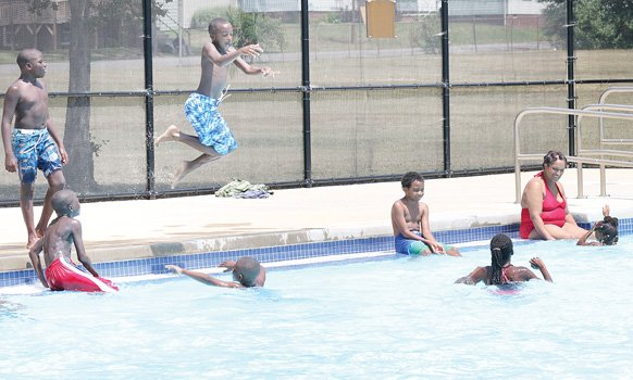 Children enjoy a splash in the city's Fairmount Pool in the East End. They're starting to take their final dips as the city will close all of its outdoor pools when schools reopen Tuesday.